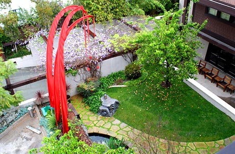 The Courtyard Features Walking Paths and a Koi Pond