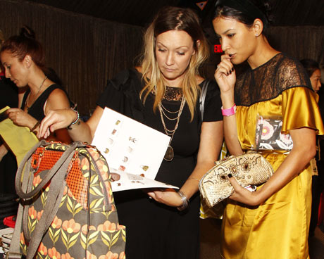 Actress Danay Garcia picking out a Petunia Pickle Bottom bag.