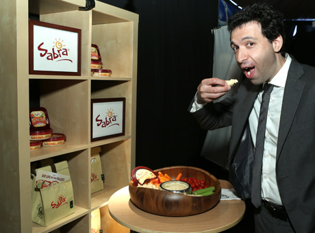 Alex Karpovsky enjoying Sabra