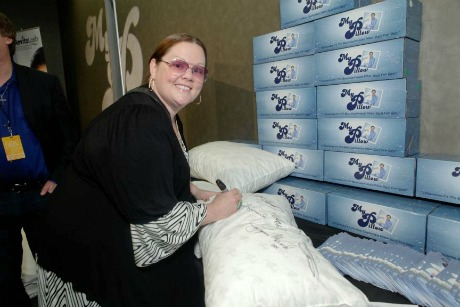 Comedian/actress Melissa McCarthy signing a MyPillow to be auctioned off for charity.