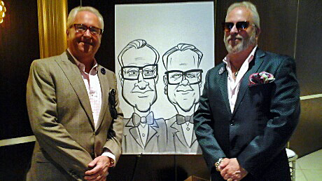 Mark Harris and Matt Harris with their caricatures.