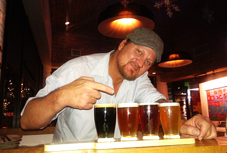 Cliff Williams, bar manager of Orlando's, with a delightful flight of different draft beers.