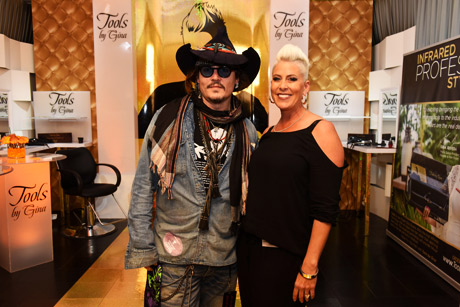 Actor/ musician Johnny Depp (L) of The Hollywood Vampires and Tools by Gina founder Gina Rivera attend the GRAMMY Gift Lounge during The 58th GRAMMY Awards at Staples Center on February 13, 2016 in Los Angeles, California.