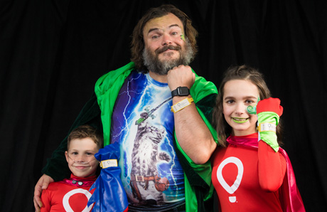 Jack Black with Miracle kids Nathan Ferrell and Jessica Meyer. Photo by Andy Halbeck