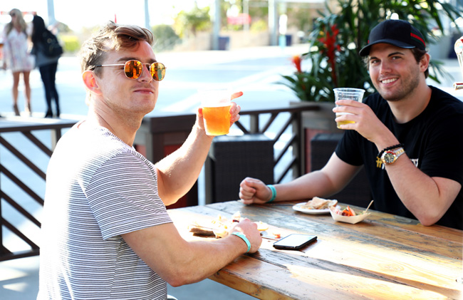 Andy Macedo and Tyler Emery enjoy some Big Wave Golden Ale at the LA Galaxy location.