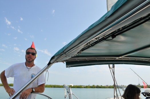 Tadd at the helm of S/V Stess