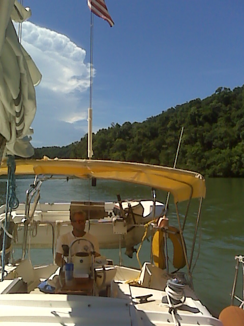Tadd driving S/V Third Aye up the Rio Dulce river