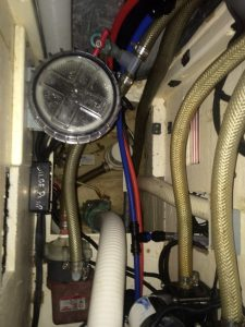 After untangling the mess of hoses and wires, I can now see all the way down to the bilge!