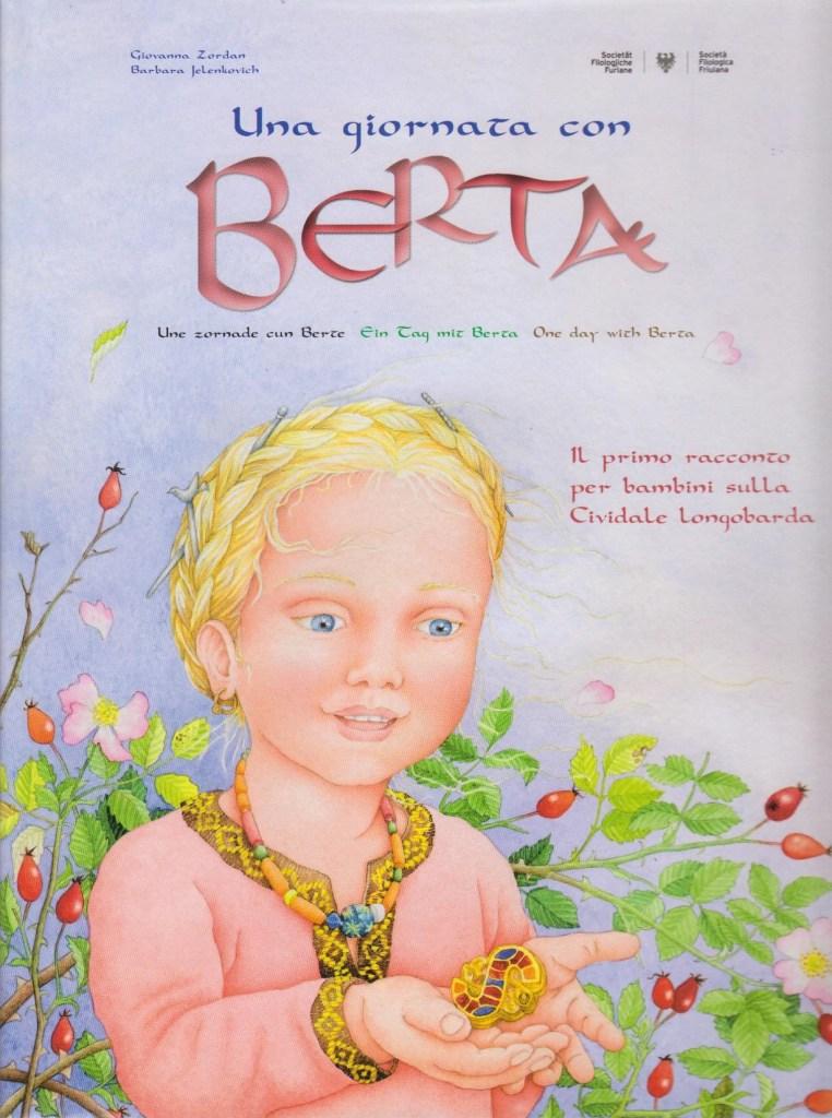La copertina del libro illustrato per bambini che narra il mondo materiale e culturale longobardo. Il testo è presente in quattro lingue: italiano, friulano, tedesco e inglese