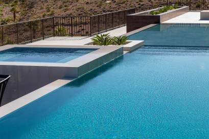 Infinity Edge Swimming Pool Water Feature with Perimeter-Overflow Hot Tub Design