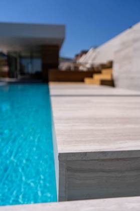 Custom Modern Swimming Pool Design with Limestone Floating Steps by Clarity Pool Service