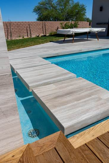 Close-up of Natural Limestone Floating Steppers - Custom Swimming Pool Design Services