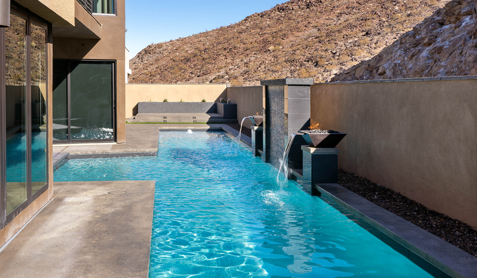 The Ultimate Custom Water Wall and Fire and Water Features - Custom Swimming Pool by Clarity Pool Service of Southern, Nevada