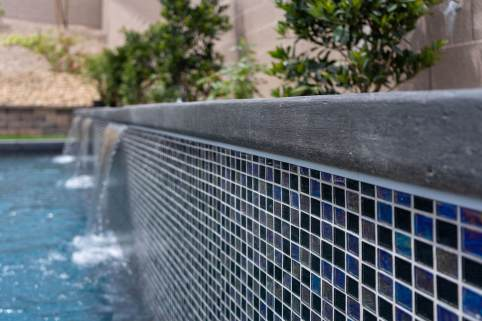 Close-up of Retaining Water Wall Tile Finish - Clarity Pool Service of Southern Nevada