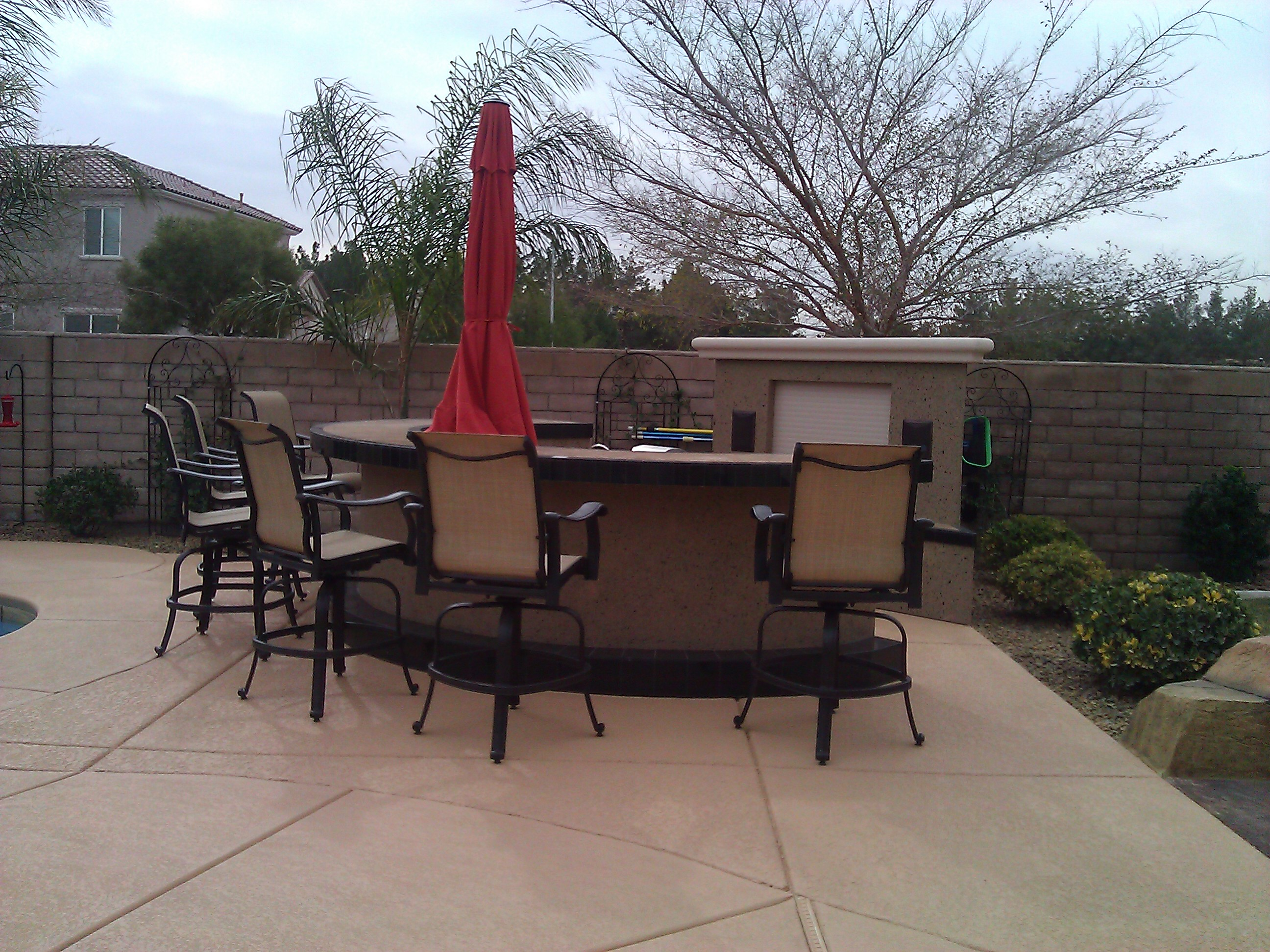 Outdoor Social Bar with Umbrella  Las Vegas Outdoor Kitchen