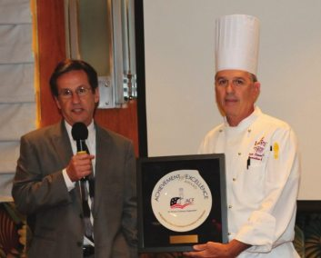 Member Ed Lepere the Manager of Lawry's is presented with the American Culinary Federation Award which was presented to Lawry's head chef Dave Simmons.
