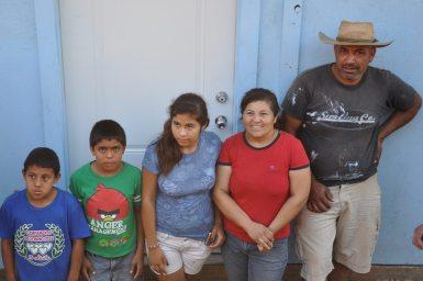 carmen-carlos-and-kids-receive-house-keys