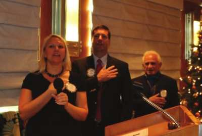 Jaime Goldsmith, President Dave and Jerry led the club in song.