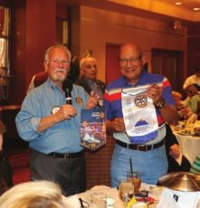 Bob Werner exchanges banners with an international Rotary member from the Philippines.