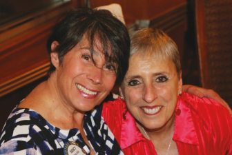 Nancy Slitz is moving to Colorado and poses with Janet Linder for a going away photo.