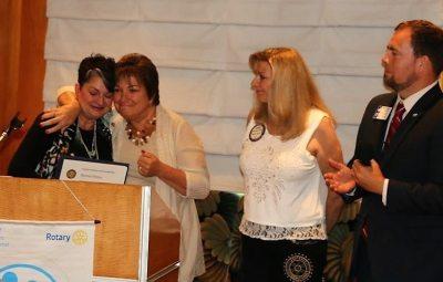 Deb Granda presented Bob Patten's wife Deanna with a PHF.