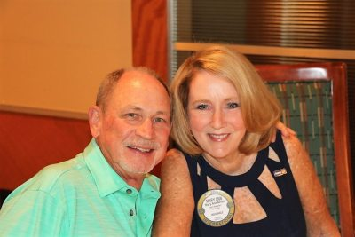 Past president Mary Ann poses with her husband Steve.