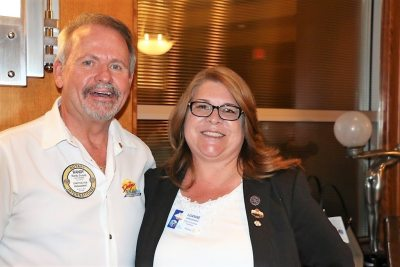 """Past president Randy Donald introduces District Governor Nominee 2019-2020 Luanne """"Lu"""" Arredondo."""