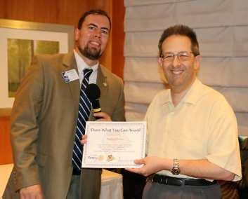 Our speaker Dr. Michael Green was presented with our Share What You Can Award