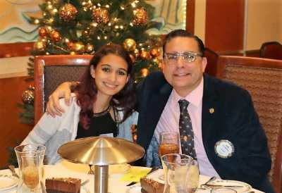 Anil Melnick enjoys lunch in the company of his daughter Mia.