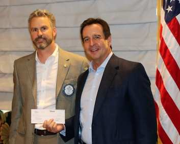 PE Jim Kohl presented a check for $5,000 to Miracle Flights administrator Mark Brown.