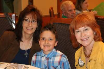 Luanne Wagner and her grandson Mathew and his godmother Arleen Sirois pose for a picture.