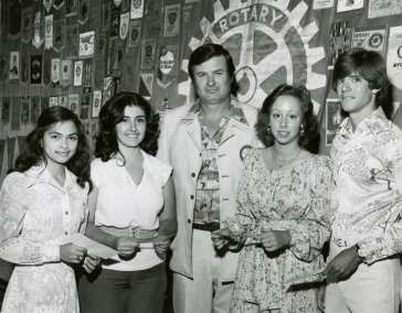 Pres Dace Welles with scholarship winners 1977