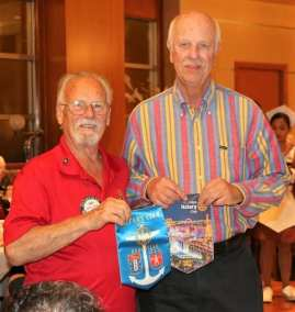 Bob Werner exchanged Banners with our Rotarian guest from France.