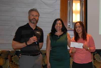 President Jim Kohl and Jennifer Carlson presented a $5K check to Kim Gradisher for the Tyler Robinson Foundation.