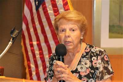 """Marie Walsh led us in song with """"God Bless America."""""""