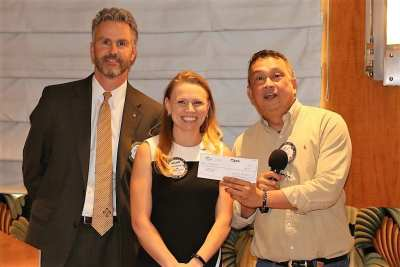 President Jim and Melanie Muldowney presented a check to Mike Cudiamat to be used in a medical Clinic in the Philippines.
