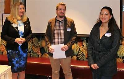 President Elect Jackie Thornhill awards V.R. Kids representative R.J. Sampson with a $1,440 grant.