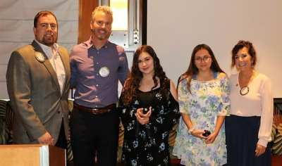 PP/AG Michael and President Jim posed for a picture with Francesca Gilbert and her Daughters Alyssa and Natalie who were awarded level II Paul Harris Fellowships by their mother.