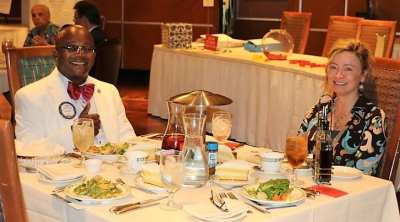 Seated and President Jim's head table was his wife Judith and Kim Nyoni