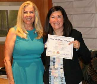President Jackie presented our guest speaker Sarah Robinson from ShelterBox with our Share What You Can Award.
