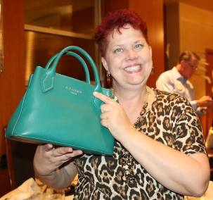 Janet Lencke showed off her Red Cuckoo purse from London. Who's the Cuckoo the red head or the purse?
