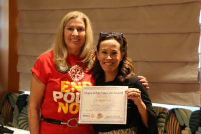 "President Jackie presented our speaker Dr. Michelle Paul with our ""Share What You Can Award""."