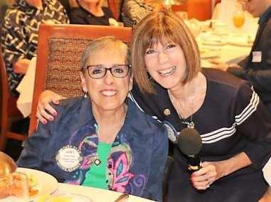 SAA Toni Kern gives her friend Janet Linder a hug.