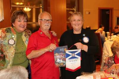 Sergeant at Arms Deb Granda joined Bob Werner in exchanging Banners with a visitor from Scotland.