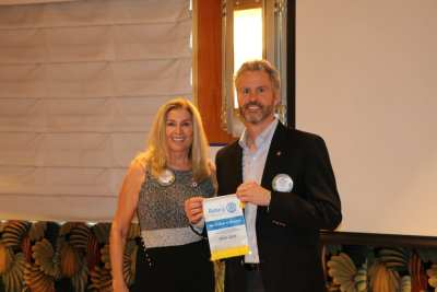 President Jackie presented a District banner to PP Jim Kohl for taking 3rd place in Rotary Giving.