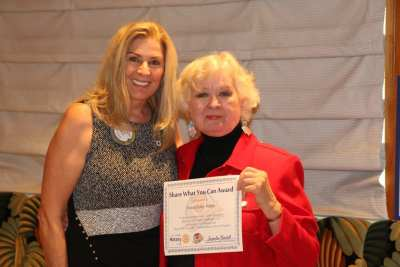 """President Jackie presents our speaker Donna Foley Mabry with our """"Share What You Can Award""""."""