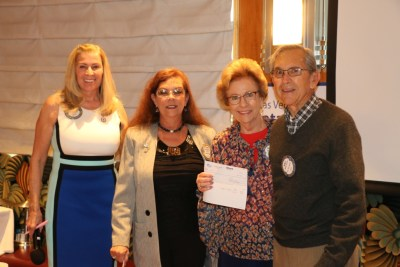 President Jackie presented checks to our Superbowl winners, PP Karen Whisenhunt, Carolyn Sparks and Walt Parrish.