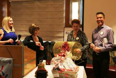 President Jackie, Toni Kern and Janet Lencke congratulated Dan Adamson on winning our raffle.