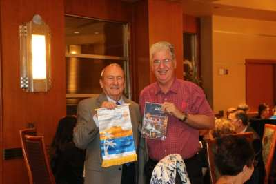 Brock Fraser exchanged banners with a Rotarian from Australia.
