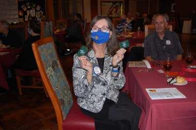 Susan Ziobro receives the trivia contest prize.